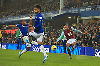 26th December 2019; Goodison Park, Liverpool, Merseyside, England; English Premier League Football, Everton versus Burnley; Dwight McNeil of Burnley crosses the ball into the penalty area as Djibril Sidibe and Mason Holgate of Everton attempt to block - Strictly Editorial Use Only. No use with unauthorized audio, video, data, fixture lists, club/league logos or 'live' services. Online in-match use limited to 120 images, no video emulation. No use in betting, games or single club/league/player publications