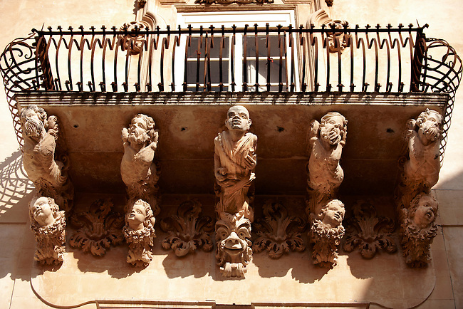 Baroque Sicilian Balcony support Sculptures of the Villadorata palace, Noto, Sicily. UNESCO World Heritage Site