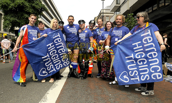 Pride London 2013 Parade through the streets of the capital to support Gay rights. An estimated 25,000 people took part. <br /> London, UK, 29th June 2013.<br /> terrence higgins trust blue flags <br /> CAP/PP/BK<br /> &copy;Bob Kent/PP/Capital Pictures