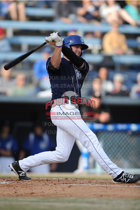 Asheville Tourists third baseman Ryan McMahon #5 swings at a pitch during a game against the Delmarva Shorebirds at McCormick Field on April 5, 2014 in Asheville, North Carolina. The Tourists defeated the Shorebirds 5-3. (Tony Farlow/Four Seam Images)