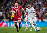 Karim Benzema (R) of Real Madrid is followed by Niklas Sule of FC Bayern Munich during the UEFA Champions League Semi-final 2nd leg match between Real Madrid and Bayern Munich at the Estadio Santiago Bernabeu on May 01 2018 in Madrid, Spain. Photo by Diego Souto / Power Sport Images