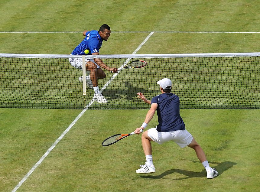 Jo-Wilfried Tsonga in action with partner Nicolas Mahut  against Jamie Murray and Andy Murray in their doubles match today<br /> <br /> Photographer Ashley Western/CameraSport<br /> <br /> International Tennis - 2015 Davis Cup by BNP Paribas - World Group Quarterfinals - Great Britain v France - Day 2 - Saturday 18th July 2015 - Queens Club - London<br /> <br /> &copy; CameraSport - 43 Linden Ave. Countesthorpe. Leicester. England. LE8 5PG - Tel: +44 (0) 116 277 4147 - admin@camerasport.com - www.camerasport.com.