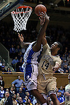 31 December 2014: Wofford's Spencer Collins (14) fouls Duke's Justise Winslow (left). The Duke University Blue Devils hosted the Wofford College Terriers at Cameron Indoor Stadium in Durham, North Carolina in a 2014-16 NCAA Men's Basketball Division I game.