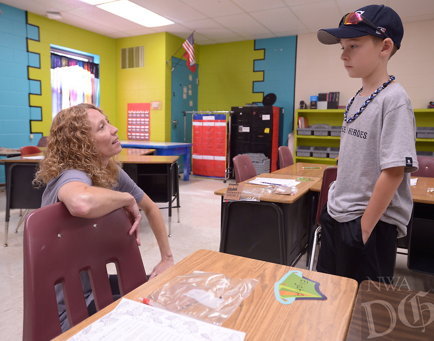 NWA Democrat-Gazette/ANDY SHUPE<br /> Beverly Workman (left), a longtime third-grade teacher at Greenland Elementary School, speaks Thursday, Aug. 9, 2018, with incoming student Tommy Gunn, 8, during an open house at the school. The district starts new teachers with a bachelor's degree at $34,513, one of five Northwest Arkansas school districts that start new teachers at $35,000 or less.
