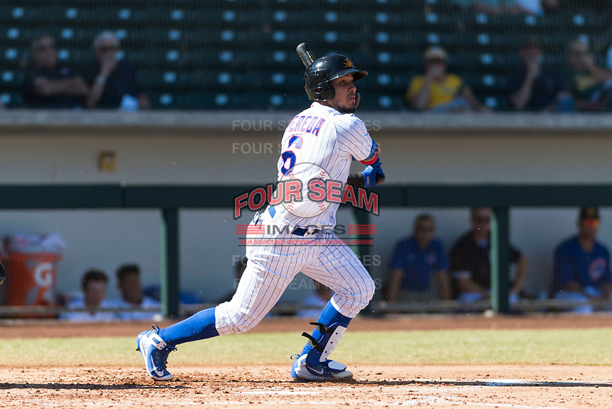 Mesa Solar Sox catcher Jhonny Pereda (6), of the Chicago Cubs organization, follows through on his swing during an Arizona Fall League game against the Salt River Rafters at Sloan Park on October 30, 2018 in Mesa, Arizona. Salt River defeated Mesa 14-4 . (Zachary Lucy/Four Seam Images)