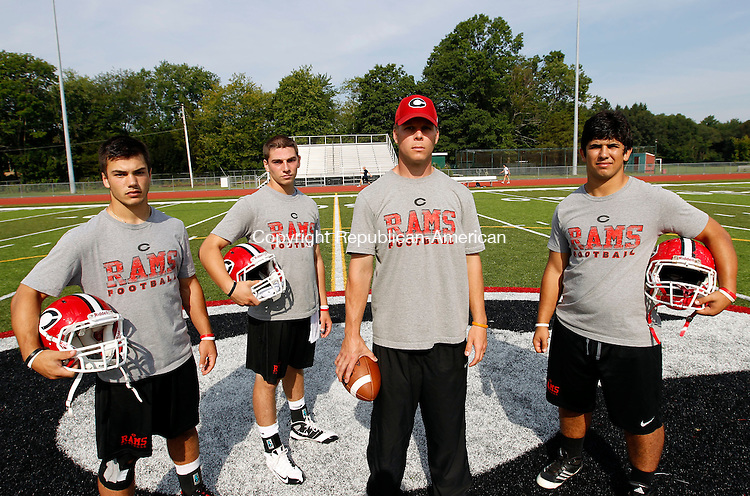 Cheshire, CT-24 August 2012-082412CM02-  L-R, Cheshire footballs, Sam Pascale, Vincent Sansone, Coach Don Drust and Matt Escoto.  Christopher Massa Republican-American