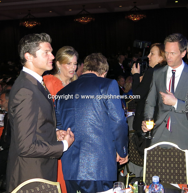 EXCLUSIVE: Elton John and David Furnish grab Neil Patrick Harris's butt while posing for photo at the 20th Annual Race To Erase MS Gala 'Love To Erase MS' at The Hyatt Regency Century Plaza Hotel in Century City, CA.<br />