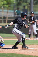 Chicago White Sox catcher Zach Collins (33) follows through on his swing during an Instructional League game against the Los Angeles Dodgers on September 30, 2017 at Camelback Ranch in Glendale, Arizona. (Zachary Lucy/Four Seam Images)