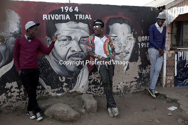 SOWETO, SOUTH AFRICA : Sibu FDB, (c) a young designer part of the collective group Smarteez at with colleagues in front of Mandela murals close to Regina Mundi church in Soweto, South Africa. Known for their street style fashion they had a great opportunity recently to show their township inspired designs at South African fashion week. Soweto today is a mix of old housing and newly constructed townhouses. A new hungry black middle-class is growing steadily. Many residents work in Johannesburg but the last years many shopping malls have been built, and people are starting to spend their money in Soweto. ( Per-Anders Pettersson)