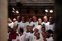 Sacerdoti cantano in coro durante la messa del Corpus Domini nella Basilica di San Giovanni in Laterano, Roma, 23 giugno 2011..Priests sing in chorus during the Corpus Domini mass at St. John Lateran's Basilica, Rome, 23 june 2011..UPDATE IMAGES PRESS/Riccardo De Luca