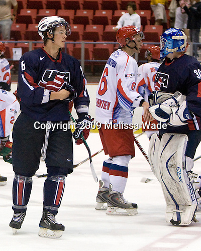 AJ Jenks (US - 18), Anton Klementyev (Russia - 6), Mike Lee (US - 30) - Team Russia defeated Team USA 6-4 in their third game in the 1980/Herb Brooks (international-size) Rink on Friday, August 14, 2009, during the 2009 USA Hockey National Junior Evaluation Camp in Lake Placid, New York.
