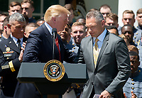 United States President Donald J. Trump greets head coach Jeff Monken as he presents the Commander-in-Chief&rsquo;s Trophy to the U.S. Military Academy football team in the Rose Garden of the White House in Washington, DC on Tuesday, May 1, 2018.  The Commander-in-Chief's trophy is presented to the winner of the annual Army-Navy football game which was played at Lincoln Financial Field in Philadelphia, Pennsylvania on December 9, 2017.  The Army Black Knights beat the Navy Midshipmen 14 - 13.<br /> Credit: Ron Sachs / CNP /MediaPunch