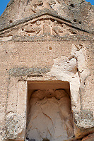 close up of the facade and relief sculptures of the Phrygian temple of Aslankaya, 7th century BC. Phyrigian Valley, Emre Lake, near Doger, Turkey.<br />