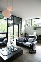 A dining area adjoins the living space and both have easy access to the adjacent balcony via a glass door