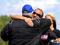May 19, 2014; Commerce, GA, USA; NHRA pro stock motorcycle rider Matt Smith gives a hug to father, pro mod driver Rickie Smith after winning the Southern Nationals at Atlanta Dragway. Mandatory Credit: Mark J. Rebilas-USA TODAY Sports