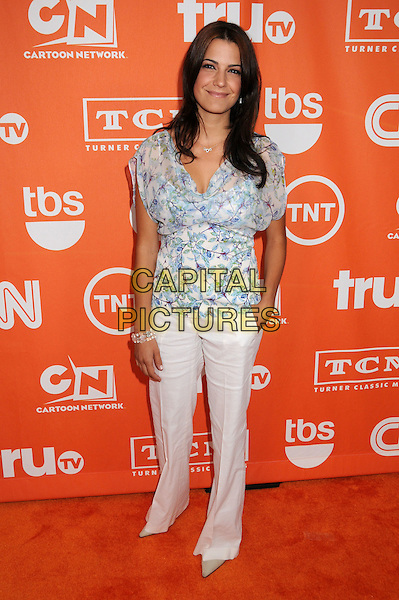 NATALIA CIGLIUTI.Turner Summer 2008 TCA Party at the Beverly Hilton Hotel, Beverly Hills, California, USA..July 11th, 2008.full length white trousers blue pattern blouse hand in pocket .CAP/ADM/BP.©Byron Purvis/AdMedia/Capital Pictures.