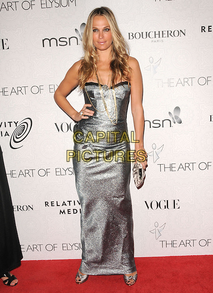 "MOLLY SIMS.Art of Elysium 3rd Annual Black Tie charity gala '""Heaven"" held at 990 Wilshire Blvd in Beverly Hills, California, USA, .January 16th 2010 .full length silver gold necklace bustier straps chain strapless grey gray clutch bag hand on hip maxi.CAP/RKE/DVS .©DVS/RockinExposures/Capital Pictures"