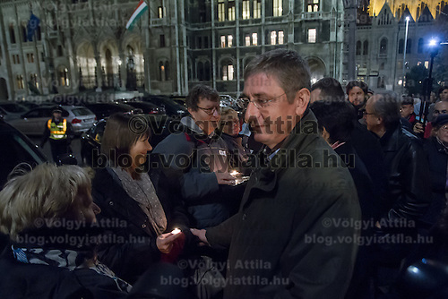 Ferenc Gyurcsany former Pime Minister of Hungary, leader of opposition group Democratic Coalition greets demonstrators who form a human chain around Parliament to protest election law changes in Budapest, Hungary on November 19, 2012. ATTILA VOLGYI