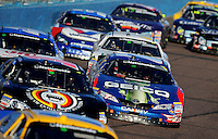Nov. 8, 2008; Avondale, AZ, USA; NASCAR Nationwide Series driver Mike Wallace (7) races in traffic during the Hefty Odor Block 200 at Phoenix International Raceway. Mandatory Credit: Mark J. Rebilas-