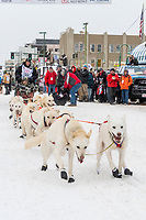 Jim Lanier and team leave the ceremonial start line with an Iditarider and handler at 4th Avenue and D street in downtown Anchorage, Alaska on Saturday March 7th during the 2020 Iditarod race. Photo copyright by Cathy Hart Photography.com
