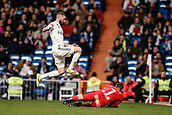 3rd February 2019, Santiago Bernabeu, Madrid, Spain; La Liga football, Real Madrid versus Alaves; Karim Benzema (Real Madrid) jumps over goalkeeper Pacheco (alv) who gathers the through ball