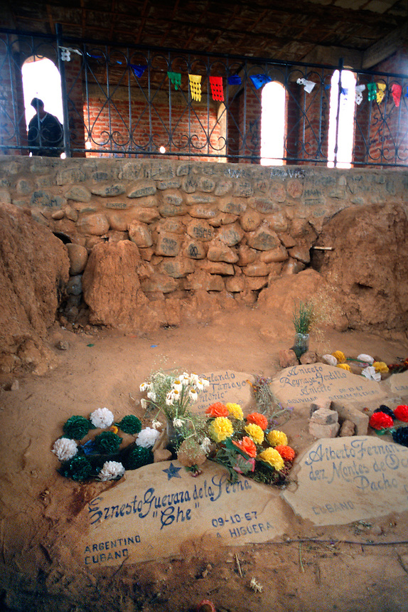"Flowers sit next to a marker for Ernesto ""Che"" Guevara in Vallegrande, Bolivia Saturday, Nov. 13, 2004, where the body of the executred Ernesto ""Che"" Guevara was lay burried with six fellow guerillas for 30 years. A mausoleum now stands over the open mass grave. The remains were repatriated to Cuba after their discovery in 1997. Guevara was captured by the Bolivian army in 1967 in a nearby valley and executed in La Higuera days later. Guevara and fellow communist guerillas were attempting to launch a continent-wide revolution modeled on Guevara's success in Cuba in the late 1950s. The Bolivian government recently began promoting the area where he fought, was captured, killed and burried for 30 years as the ""Ruta del Che,"" or Che's Route. (Kevin Moloney for the New York Times)"