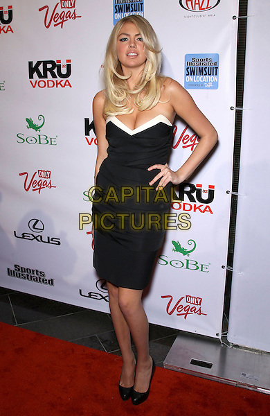 Kate Upton.The 2012 Sports Illustrated Swimsuit Models celebrate at the SI Swimsuit On Location Event at Haze Nightclub at Aria Resort and Casino, Las Vegas, Nevada, USA..February 15th, 2012.full length hand on hip dress black white trim cleavage .CAP/ADM/MJT.© MJT/AdMedia/Capital Pictures.