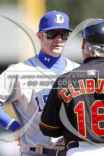 May 25, 2009:  Second Baseman Joe Dillon (15) of the Durham Bulls, International League Triple-A affiliate of the Tampa Bay Rays, talks to Red Wings Manager Stan Cliburn during a game at Frontier Field in Rochester, NY.  Photo by:  Mike Janes/Four Seam Images