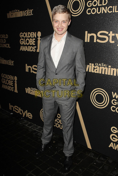 Noel Fisher.The Hollywood Foreign Press Association And InStyle Miss Golden Globe 2013 Party held at Cecconi's Restaurant, West Hollywood, California, USA, 29th November 2012..full length suit white shirt hands in pockets grey gray .CAP/ADM/KB.©Kevan Brooks/AdMedia/Capital Pictures.