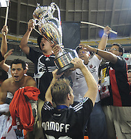 DC United defender Ryan Namoff (26) lifts the Lamar Hunt US. Open Cup Trophy to celebrate with the fans after the win, DC United defeated The Charleston Battery 2-1, to win the  Lamar Hunt U.S. Open Cup at RFK Stadium in Washington DC, Saturday September 3, 2008.