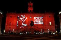 Roma 25-11-2013 Installazione luminosa al Campidoglio, che viene illuminato di rosso con la scritta Stop violence against women, per la giornata contro la violenza sulle donne.<br /> Campidoglio enlighten to stop violence against women<br /> Photo Samantha Zucchi Insidefoto