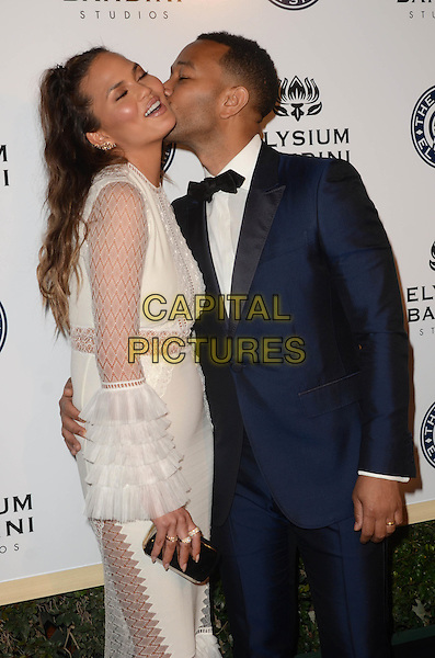 LOS ANGELES, CA - JANUARY 7: Chrissy Teigen, John Legend at the The Art Of Elysium Tenth Annual Celebration 'Heaven' Charity Gala at Red Studios in Los Angeles, California on January 7, 2017. <br /> CAP/MPI/DE<br /> &copy;DE/MPI/Capital Pictures