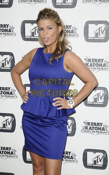 "KERRY KATONA.The launch of her new MTV series ""Kerry: What's The Problem?"", Charlotte Street Hotel, London, England..May 5th, 2009.half 3/4 length blue purple sleeveless dress skirt top layer ruffle hands on hips bracelet white watch poking sticking tongue out .CAP/CAN.©Can Nguyen/Capital Pictures."