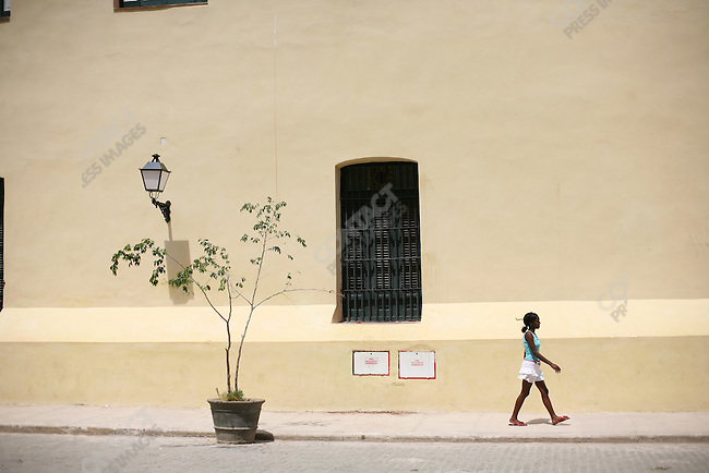 ©2008 David Burnett / Contact Press Images..July 12 2008..Havana, Cuba.Scenes in old Havana.Neighborhood fruit market, electric panels in old apartment,.at 274 Prado, a workman where the renovations of the building are just starting to convert it back to a cafe/bar