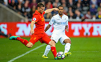 Swansea'sWayne Routledge puts pressure on Wayne Routledge  at The Liberty Stadium on October 1, 2016 in Swansea, Wales, as Liverpool take on the Swans.
