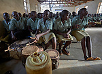 Girls sing and play drums during Catholic Mass in Lugi, a village in the Nuba Mountains of Sudan. The area is controlled by the Sudan People's Liberation Movement-North, and frequently attacked by the military of Sudan.