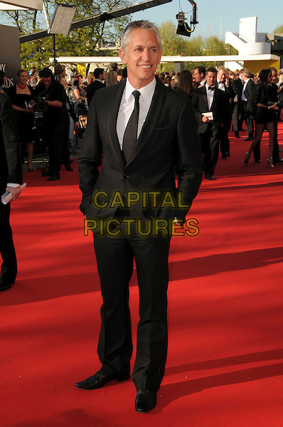 GARY LINEKER.Arrivals at the British Academy Television Awards 2009, Royal Festival Hall, London, England. .April 26th 2009 .TV Baftas bafta's full length black suit hands in pockets .CAP/CAS.©Bob Cass/Capital Pictures..