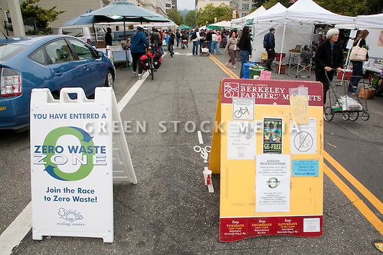 Zero Waste Zone Sign and Bulletin Board at Ecology Center's Berkeley Farmers' Market which prides itself on being a 'Zero Waste Zone' and prohibiting genetically modified foods. Berkeley, California, USA