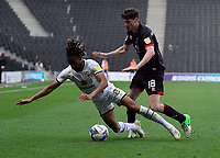 Lincoln City's Conor McGrandles vies for possession with Milton Keynes Dons' David Kasumu<br /> <br /> Photographer Chris Vaughan/CameraSport<br /> <br /> The EFL Sky Bet League One - Milton Keynes Dons v Lincoln City - Saturday 19th September 2020 - Stadium MK - Milton Keynes<br /> <br /> World Copyright © 2020 CameraSport. All rights reserved. 43 Linden Ave. Countesthorpe. Leicester. England. LE8 5PG - Tel: +44 (0) 116 277 4147 - admin@camerasport.com - www.camerasport.com