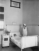 Nurse and patient in ward of Sharei Zedek Hospital with donor plaque, by Tsadok Bassan, early 20th century