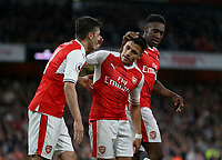 Arsenal's Alexis Sanchez is congratulated after scoring his sides first goal by Mesut Ozil and Danny Welbeck<br /> <br /> Photographer Rob Newell/CameraSport<br /> <br /> The Premier League - Arsenal v Sunderland - Tuesday May 16th 2017 - Emirates Stadium - London<br /> <br /> World Copyright &copy; 2017 CameraSport. All rights reserved. 43 Linden Ave. Countesthorpe. Leicester. England. LE8 5PG - Tel: +44 (0) 116 277 4147 - admin@camerasport.com - www.camerasport.com