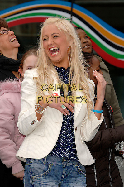 """CHANTELLE HOUGHTON.launch of """"Bullywatch"""" charity at City Hall.London, England  22nd March 2006.Ref: PL.winner of Celebrity Big Brother half length white pinstripe jacket laughing blue rubber bracelet ring.www.capitalpictures.com.sales@capitalpictures.com.©Capital Pictures"""