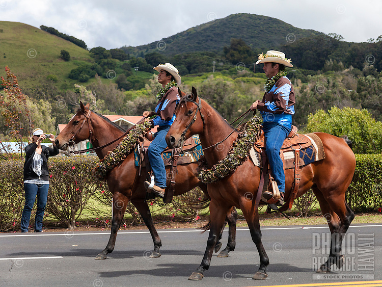 Riders participate in the Waimea Paniolo Parade on the Big Island.