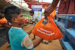 Rohingya refugees unload food supplies for distribution to other refugees in the Chakmarkul Refugee Camp near Cox's Bazar, Bangladesh, where ICCO Cooperation and other members of the ACT Alliance provide humanitarian support for the refugees. <br /> <br /> More than 600,000 Rohingya have fled government-sanctioned violence in Myanmar for safety in Bangladesh.