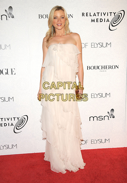 "AMY SMART .at Art of Elysium 3rd Annual Black Tie charity gala '""Heaven"" held at 990 Wilshire Blvd in Beverly Hills, California, USA, January 16th 2010 .                                                                  arrivals full length white dress long maxi ruffles ruffle tiered  strapless clutch bag .CAP/RKE/DVS.©DVS/RockinExposures/Capital Pictures"