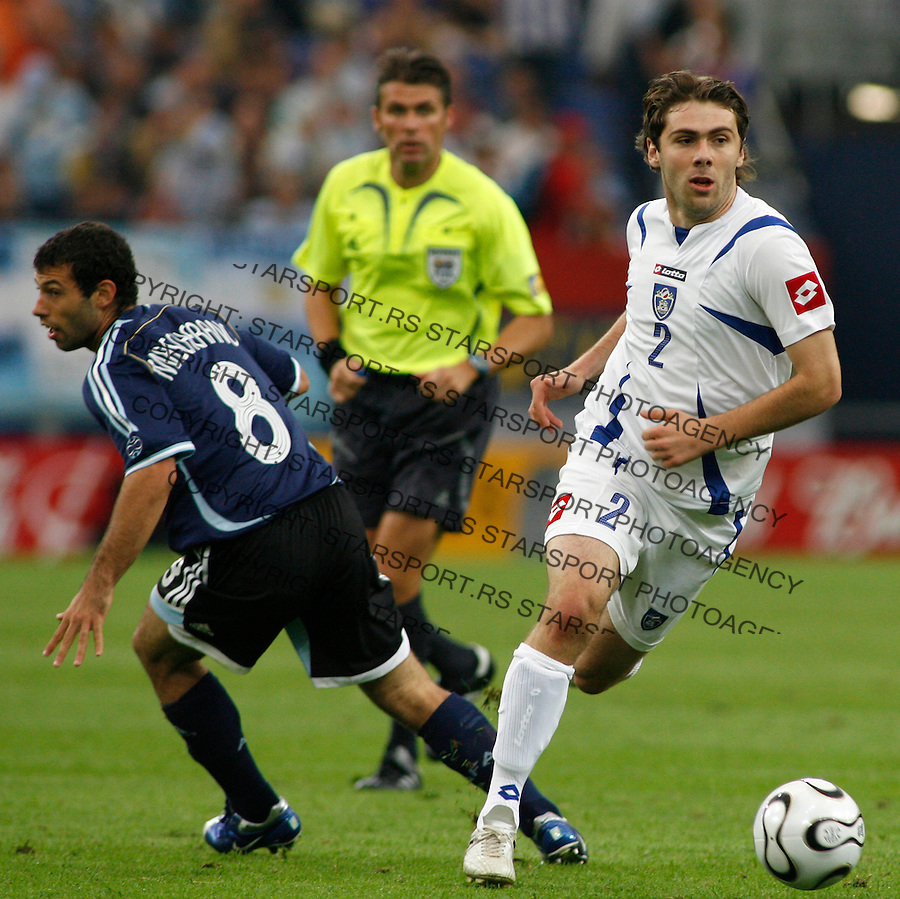 Jun 16, 2006; GELSENKICHEN, Germany; Serbian midfielder ERGIC Ivan (2) drive past Argentina's midfielder MASCHERANO Javier (8), during the opening round FIFA World Cup soccer match between Argentina & Serbia and Montenegro, at the World Cupa Arena at GELSENKICHEN, Germany. Argentina beat Serbia 6-0.Mandatory Credit: Srdjan Stevanovic-CAL SPORT MEDIA Copyright © 2006 Srdjan Stevanovic..