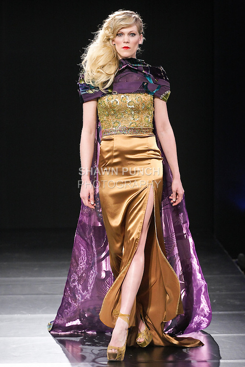 Model walks runway in an outfit by Andres Aquino, for the Andres Aquino Fall 2011 fashion show, during Couture Fashion Week Fall 2011.