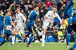Cristiano Ronaldo (r) of Real Madrid shoots past the Nemanja Radoja of RC Celta de Vigo during their Copa del Rey 2016-17 Quarter-final match between Real Madrid and Celta de Vigo at the Santiago Bernabéu Stadium on 18 January 2017 in Madrid, Spain. Photo by Diego Gonzalez Souto / Power Sport Images