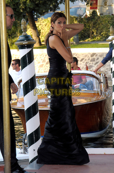 """EVA MENDES .At the """"Bad Lieutenant: Port Of Call New Orleans""""  film premiere during the .66th Venice International Film Festival, Palazzo del Casino, Lido, Venice, Italy, .4th September 2009..full length black dress long maxi corsage  arriving walking hand over mouth blowing kiss gesture .CAP/RD .©Richard Dean/Capital Pictures"""