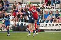 Kansas City, Mo. - Saturday April 23, 2016: FC Kansas City midfielder Mandy Laddish (7) and Portland Thorns FC defender Emily Sonnett (16) fight for the ball during a match at Swope Soccer Village. The match ended in a 1-1 draw.